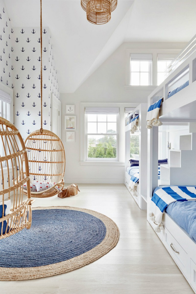 For a more subtle marine décor add a simple pattern wallpaper in just one of the walls for example the anchors wallpaper on the image